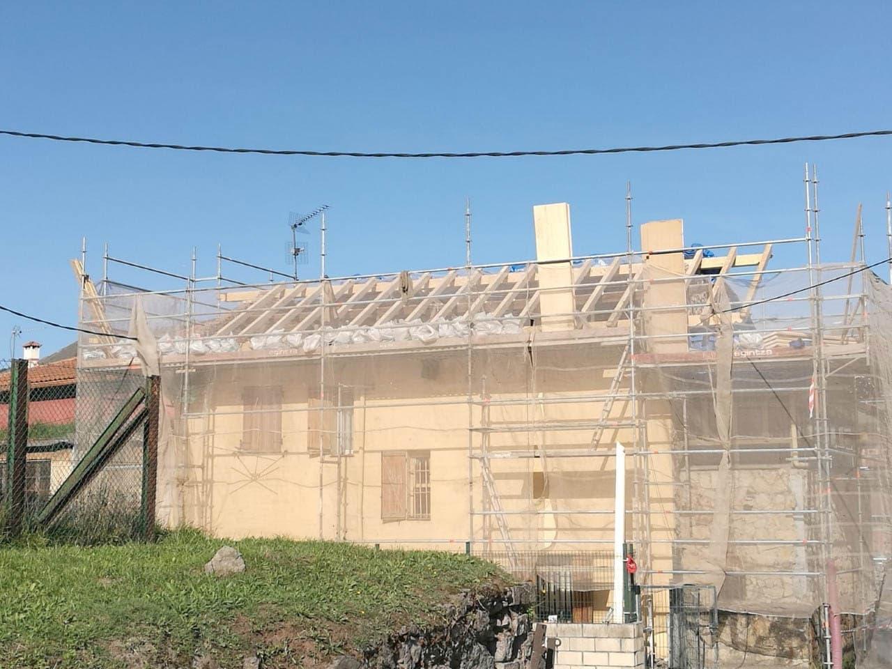 Rehabilitación de fachada y tejado casa campo